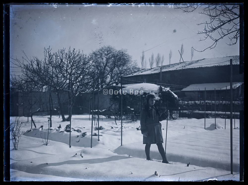 girl in garden covered with snow France 1933