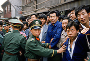Army officers control crowd for VIP visit in Shanghai, China in 1980s