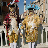 VENICE, ITALY - FEBRUARY 26:  Two men wearing Carnival costumes and masks pose near St Mark Square on February 26, 2011 in Venice, Italy.  The Venice Carnival, one of the largest and most important in Italy, attracts thousands of people from around the world each year. The  theme for this year's carnival is 'Ottocento', a nineteenth century evocation, and will run from February 19 till March 8.
