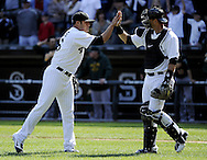 CHICAGO - JUNE 12:  Sergio Santos #46 celebrates with A.J. PIerzynksi #12 of the Chicago White Sox after the game against the Oakland Athletics on June 12, 2011 at U.S. Cellular Field in Chicago, Illinois.  The White Sox defeated the Athletics 5-4.  (Photo by Ron Vesely)   Subject:  Sergio Santos;A.J. Pierzynski