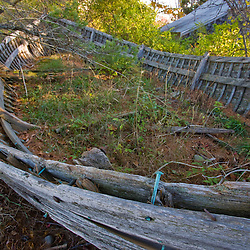 An old wooden skiff decays in the woods at Timber Point in Biddeford, Maine.