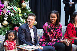 December 12, 2016 - Washington, DC, United States - On Monday, December 12, patients, families, and staff of Children's National Health System, were visited in the Main Atrium by, (l-r), 5-year-old patient Abi Soliman, Ryan Seacrest, and First Lady Michelle Obama.....Mr. Seacrest, and Mrs. Obama, answered questions from the children. (Credit Image: © Cheriss May/NurPhoto via ZUMA Press)