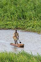 subsistance fisher rowing his dugout canoe, Caia, Zambezi River Floodplain, Sofala Province, Mozambique