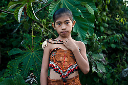 NO WEB/NO APPS - Exclusive. (Text available) Portrait of an Ese-Eja young native girl wearing the traditional clothes of her native community 'Palma Real', near Puerto Maldonado, Peru on July 17, 2017. The Amazon rainforest is famous as 'The Lung of the Earth', but also for the presence of numerous native communities, who have always lived isolated and in close contact with nature for generations, used to seek for food and medicines and to build items directly from the environment in which they live. The unstoppable rise of globalization has drastically changed their needs, expectations and consequently their way of life. Located in the Tambopata National Reserve, on the border between Peru and Bolivia, the native Comunidad Palma Real is one of the clearest examples of this change. Living on the banks of the Madre de Dios River since approximately 1976, Palma Real comprises about 300 people part of the nomadic community Ese-Eja, established in the Amazon rainforest of Peru before the Spanish colonization. Photo by Giacomo d'Orlando/ABACAPRESS.COM