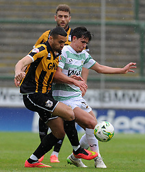 Port Vale's Colin Daniel is tackled by Yeovil Town's Liam Sheppard- Photo mandatory by-line: Harry Trump/JMP - Mobile: 07966 386802 - 25/04/15 - SPORT - FOOTBALL - Sky Bet League One - Yeovil Town v Port Vale - Huish Park, Yeovil, England.