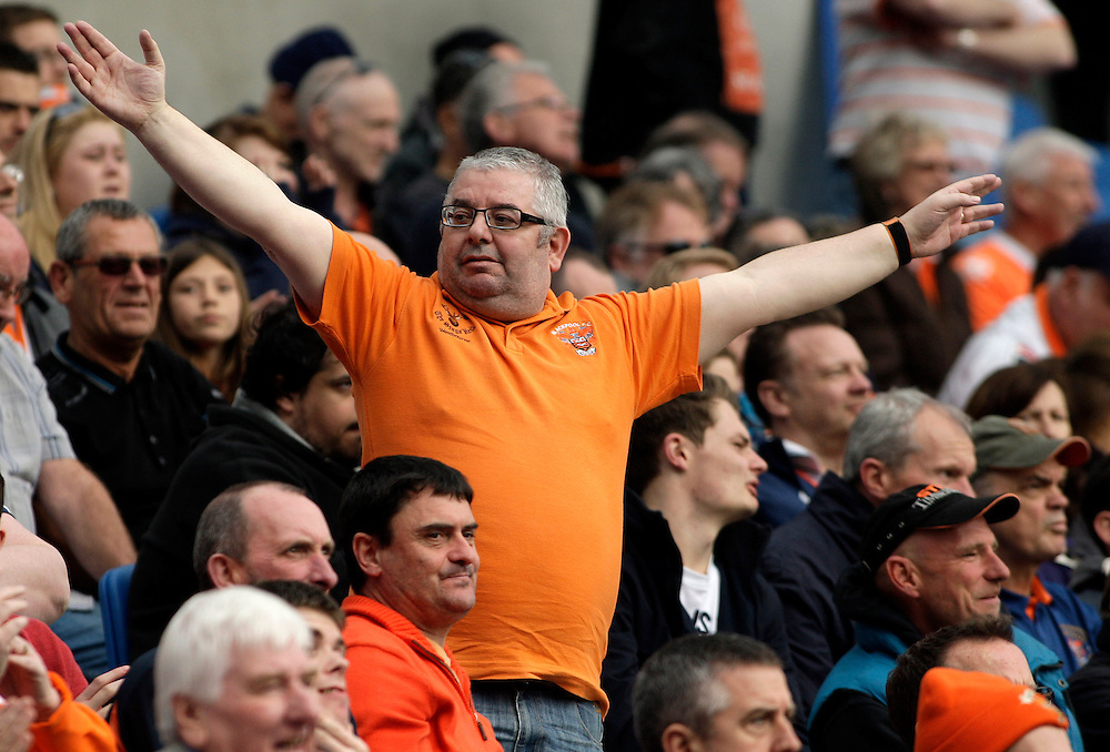 A Blackpool fan holds his arms out as he cheers on his team.<br /> <br /> Photo by James Marsh/CameraSport<br /> <br /> Football - The Football League Sky Bet Championship - Brighton and Hove Albion v Blackpool - Monday 21st April 2014 - American Express Community Stadium - Brighton<br /> <br /> © CameraSport - 43 Linden Ave. Countesthorpe. Leicester. England. LE8 5PG - Tel: +44 (0) 116 277 4147 - admin@camerasport.com - www.camerasport.com