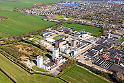 Nederland, Friesland, Gemeente Skarsterlan (Scharsterland), 01-05-2013; Joure, fabriek van Douwe Egberts met Haskerveenpolder en nieuwbouwwijk Skipsleat.<br /> Coffee Factory of the Douwe Egberts Company in the polder. <br /> luchtfoto (toeslag op standard tarieven)<br /> aerial photo (additional fee required)<br /> copyright foto/photo Siebe Swart