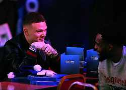 Tottenham players Kieran Trippier and Danny Rose watch the action during day three of the William Hill World Darts Championships at Alexandra Palace, London.
