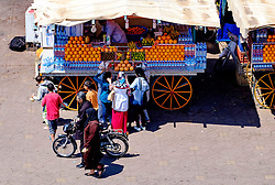 People buying fresh orange drinks from a market stall in the Jemaa el Fna, Marrakech, Morocco, North Africa<br /> <br /> (c) Andrew Wilson | Edinburgh Elite media