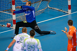 The Dutch handball player Bart Ravensbergen in action against Blaz Blagotinsek from Slovenia during the European Championship qualifying match on January 6, 2020 in Topsportcentrum Almere