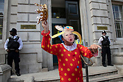 Anti Brexit protester dressed up as a clown version of Prime Minister Boris Johnson outside the Cabinet Office in Westminster as it is announced that Boris Johnson has had his request to suspend Parliament approved by the Queen on 28th August 2019 in London, England, United Kingdom. The announcement of a suspension of Parliament for approximately five weeks ahead of Brexit has enraged Remain supporters who suggest this is a sinister plan to stop the debate concerning a potential No Deal.