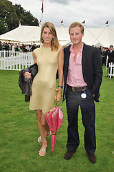 GUY PELLY and SUSANNA WARREN at the 25th annual Cartier International Polo held at Guards Polo Club, Great Windsor Park, Berkshire on 26th July 2009.