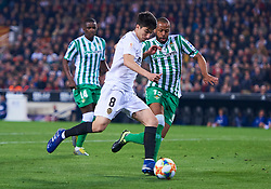 February 28, 2019 - Valencia, U.S. - VALENCIA, SPAIN - FEBRUARY 28: Carlos Soler, midfielder of Valencia CF competes for the ball with Sidnei Rechel da Silva Junior, defender of Real Betis Balompie during the Copa del Rey match between Valencia CF and Real Betis Balompie at Mestalla stadium on February 28, 2019 in Valencia, Spain. (Photo by Carlos Sanchez Martinez/Icon Sportswire) (Credit Image: © Carlos Sanchez Martinez/Icon SMI via ZUMA Press)