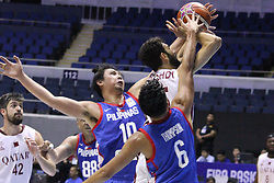 September 17, 2018 - Quezon City, NCR, Philippines - Khaled Mohamed Abdelbaset (White) of Qatar gets double teamed during a lay-up attempt by Ian Sanggalang (10, Blue) and Scottie Thompson (6, Blue) of the Philippines. (Credit Image: © Dennis Jerome S. Acosta/Pacific Press via ZUMA Wire)