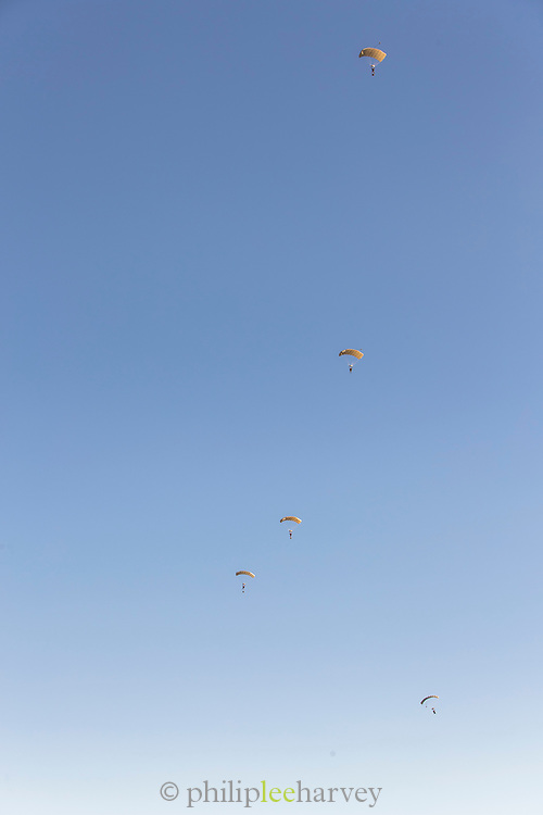 Five people parachuting in clear blue skies, Sisteron, France