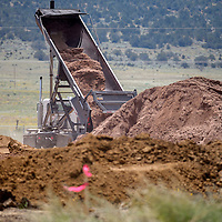 082015       Cable Hoover<br /> <br /> A truck dumps a load of dirt from Bar S Ranch in Timberlake into a Navajo Housing Authority construction on New Mexico Highway 53 Aug. 20.