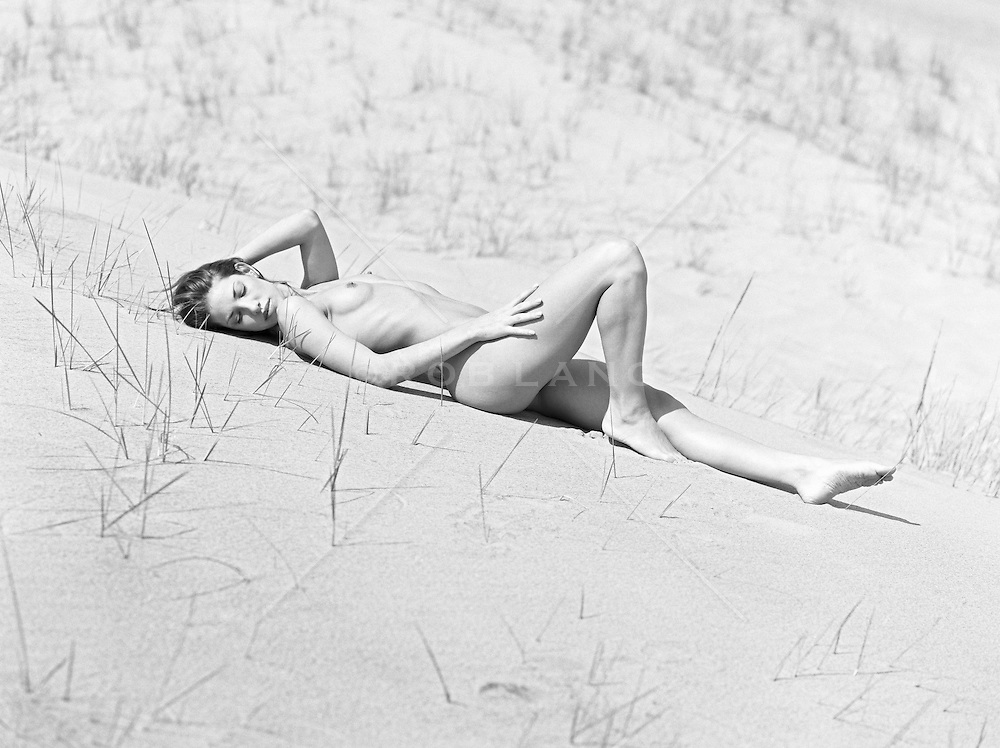 female nude on a sand dune in Amagansett, NY