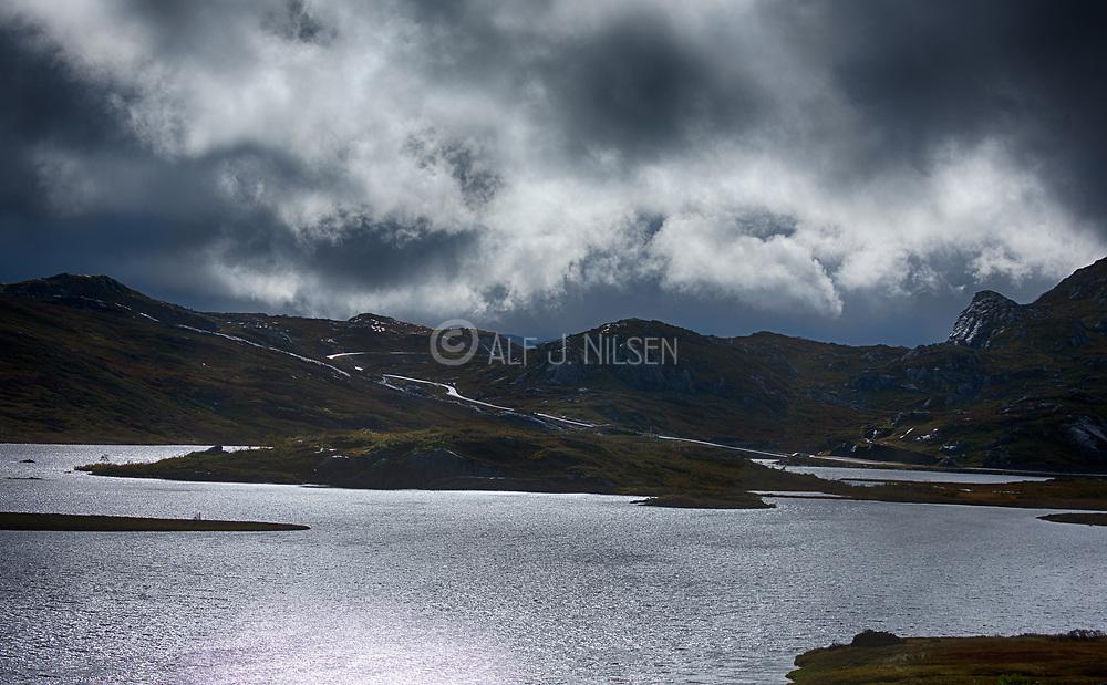 Dramatic weather along Fv237 close to Suleskar (Sirdal, Agder, Norway) looking over Håhellervatnet towards south in September.