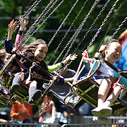 Children enjoy the fun rides during the May Fair at Saint Mark's Church, New Canaan, Connecticut, USA. 12th May 2012. Photo Tim Clayton