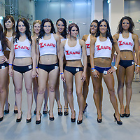 Participants pose for a group photo during the Miss Zsaru (Miss Cop) contest in Budapest, Hungary on May 13, 2012. ATTILA VOLGYI