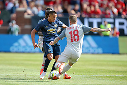 July 28, 2018 - Ann Arbor, Michigan, United States - Alexis Sanchez (7) of Manchester United FC carries the ball up the field under the pressure of Alberto Moreno (18) and Sadio Mane (10) of Liverpool during an International Champions Cup match between Manchester United and Liverpool at Michigan Stadium in Ann Arbor, Michigan USA, on Wednesday, July 28,  2018. (Credit Image: © Amy Lemus/NurPhoto via ZUMA Press)