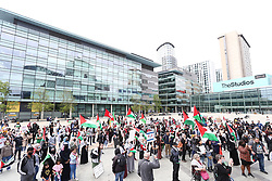 © Licensed to London News Pictures. 29/05/2021. Salford, UK.  Protesters gather is Salford at a 'Protest for Palestine' outside the BBC studios in Media City. Pro-Palestine demonstrations have been taking place worldwide in the wake of Israel's 11 day bombardment of Gaza which resulted in hundreds of civilian deaths. Photo credit: Adam Vaughan/LNP