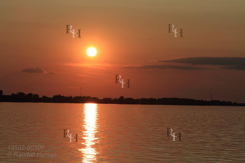 Sun sets over Sandusky Bay on Lake Erie at Sandusky, OH.