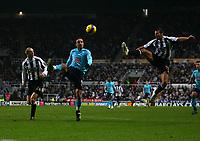 Photo: Andrew Unwin.<br />Newcastle United v Tottenham Hotspur. The Barclays Premiership. 23/12/2006.<br />Tottenham's Dimitar Berbatov (C) looks to control the ball.