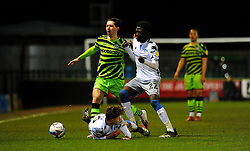 Harvey Sayer of Colchester United is fouled by Isaac Hutchinson of Forest Green Rovers - Mandatory by-line: Nizaam Jones/JMP - 27/02/2021 - FOOTBALL - The innocent New Lawn Stadium - Nailsworth, England - Forest Green Rovers v Colchester United - Sky Bet League Two