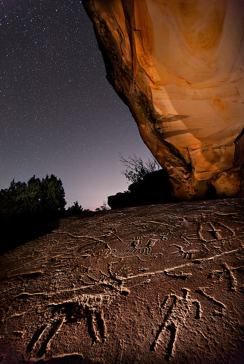 Ancient rock art adorns this sandstone slab in the canyon country of Western Colorado. It is speculated that some of the figures are Shoshone (Ute) and that some may be from the Fremont culture or even older.