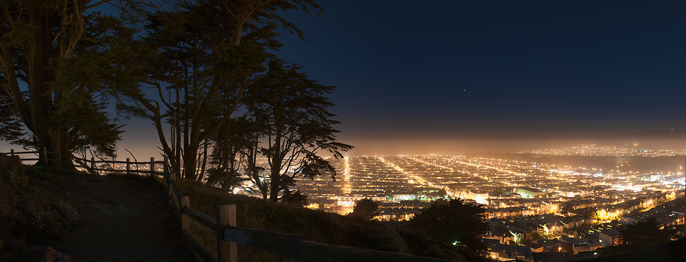 The Sunset District, Golden Gate Park and Marin can be seen on the Horizon on a moonlit night from Grand View Park. San Francisco, California.