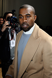 "File photo of Kanye West attending Maison Martin Margiela's Fall-Winter 2014/2015 Ready-To-Wear collection show held at Salomon de Rothschild Hotel in Paris, France on February 28, 2014. Kim Kardashian West spoke out about Kanye West's bipolar disorder Wednesday, three days after the rapper delivered a lengthy monologue at a campaign event touching on topics from abortion to Harriet Tubman, and after he said he has been trying to divorce her.Kardashian West said in a statement posted in an Instagram Story that she has never spoken publicly about how West's bipolar disorder has affected their family because she is very protective of their children and her husband's ""right to privacy when it comes to his health."" Photo by Aurore Marechal/ABACAPRESS.COM"