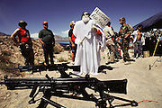 On the desert shooting range before a live fire weapons demonstration at the Soldier of Fortune Convention, Las Vegas, Nevada, USA. Iranian Ayatollah Khomeini figure was later shot and burned.