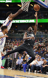 November 14, 2018 - Orlando, FL, USA - The Orlando Magic's Jerian Grant (22) shoots under Philadelphia 76ers defenders Joel Embiid, top, and Markelle Fultz, bottom left, at the Amway Center in Orlando, Fla., on Wednesday, Nov. 14, 2018. (Credit Image: © Stephen M. Dowell/Orlando Sentinel/TNS via ZUMA Wire)
