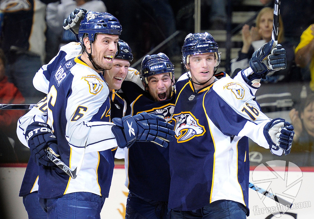 NASHVILLE, TN - OCTOBER 09:  Shea Weber #6, Ryan Suter #20, and Cal O'Reilly #16, congratulate Steve Sullivan, center, on scoring a goal against the Anaheim Ducks on October 9, 2010 in Nashville, Tennessee.  (Photo by Frederick Breedon/Getty Images)