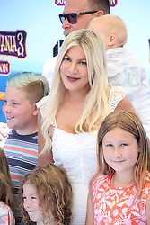 "Tori Spelling, Dean McDermott and family at the premiere of ""Hotel Transylvania 3: Summer Vacation"" held at the Westwood Village Theatre in Los Angeles"