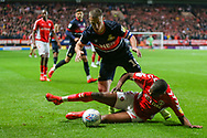Charlton Athletic defender Anfernee Dijksteel (2) and Doncaster Rovers midfielder Tommy Rowe (10) battle for the ball during the EFL Sky Bet League 1 second leg Play-Off match between Charlton Athletic and Doncaster Rovers at The Valley, London, England on 17 May 2019.
