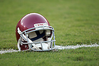 20 August 2006: Empty red player football  helmet on the field in the grass on the white line in Los Angeles, CA.