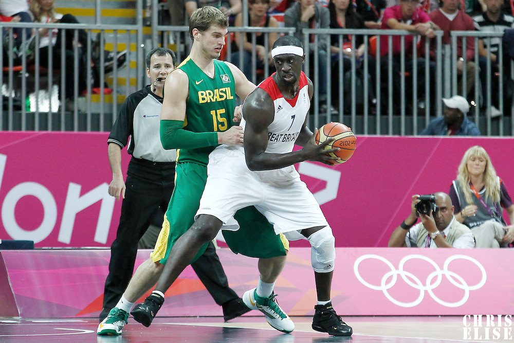 31 July 2012: Great Britain Pops Mensah-Bonsu posts up Brazil Tiago Splitter during 67-62 Team Brazil victory over Team Great Britain, during the men's basketball preliminary, at the Basketball Arena, in London, Great Britain.