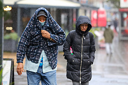 © Licensed to London News Pictures. 03/11/2020. London, UK. People are caught in heavy rainfall in north London. The Met Office forecasts rain and strong winds in the South East of England. Photo credit: Dinendra Haria/LNP