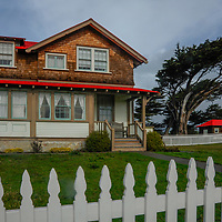 Picket fences surround lighthouse keeper's houses at Point Cabrillo Light Station in Mendocino County, California.