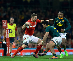 George North of Wales under pressure from Damian de Allende of South Africa<br /> <br /> Photographer Simon King/Replay Images<br /> <br /> Under Armour Series - Wales v South Africa - Saturday 24th November 2018 - Principality Stadium - Cardiff<br /> <br /> World Copyright © Replay Images . All rights reserved. info@replayimages.co.uk - http://replayimages.co.uk