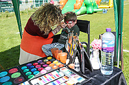 Young FGR photographer being face painted during the EFL Sky Bet League 2 match between Forest Green Rovers and Exeter City at the New Lawn, Forest Green, United Kingdom on 4 May 2019.
