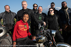 A Nepalese boy joins our group as we posed with a spectacular background of 23,000' peaks on day-4 our our Himalayan Heroes adventure riding from Pokhara to Kalopani, Nepal. Friday, November 9, 2018. Photography ©2018 Michael Lichter.