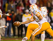 Nov 12, 2011; Fayetteville, AR, USA;  Tennessee Volunteers quarterback Justin Worley (14) looks to hand off the ball during a game against the Arkansas Razorbacks at Donald W. Reynolds Razorback Stadium. Arkansas defeated Tennessee 49-7. Mandatory Credit: Beth Hall-US PRESSWIRE