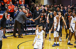 Jan 12, 2019; Morgantown, WV, USA; Oklahoma State Cowboys guard Isaac Likekele (13) reacts with players during the second half against the West Virginia Mountaineers at WVU Coliseum. Mandatory Credit: Ben Queen-USA TODAY Sports
