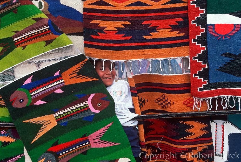 ECUADOR, MARKETS, CRAFT Otavalo Market; girl and woven textiles