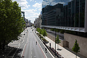 Looking along Farringdon Street on the boundary of the City of London financial district is virtually deserted as lockdown continues and people observe the stay at home message in the capital on 12th May 2020 in London, England, United Kingdom. Coronavirus or Covid-19 is a new respiratory illness that has not previously been seen in humans. While much or Europe has been placed into lockdown, the UK government has now announced a slight relaxation of the stringent rules as part of their long term strategy, and in particular social distancing.