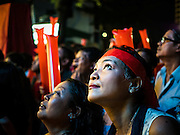 08 NOVEMBER 2015 - YANGON, MYANMAR:  National League for Democracy supporters watch the vote count Sunday on a large screen TV set up at NLD headquarters. The vote count was shown live on television. The citizens of Myanmar went to the polls Sunday to vote in the most democratic elections since 1990. The National League for Democracy, (NLD) the party of Aung San Suu Kyi is widely expected to get the most votes in the election, but it is not certain if they will get enough votes to secure an outright victory. The polls opened at 6AM. In Yangon, some voters started lining up at 4AM and lines were reported to long in many polling stations in Myanmar's largest city.   PHOTO BY JACK KURTZ