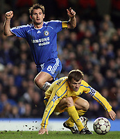 Photo: Paul Thomas.<br /> Chelsea v Levski Sofia. UEFA Champions League, Group A. 05/12/2006. <br /> <br /> Chelsea's captain Frank Lampard (L) passes the ball around Levski's captain Elin Topuzakov.